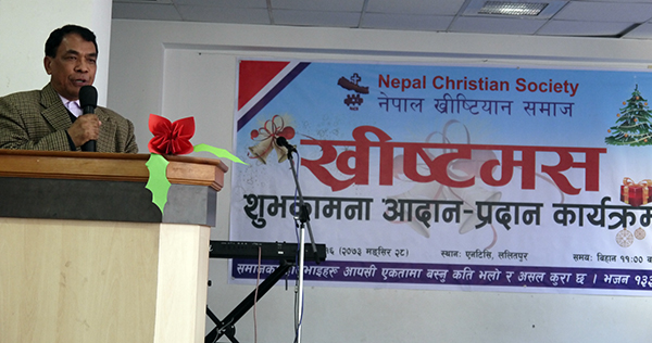 Pastor Dr. Mangal Man Maharjan is sharing the Word of God during the  Christmas greetings sharing program. Photo by Sarju Rijal